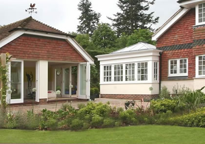 Folding Sliding Doors to Recreation Room next to Orangery in West Sussex