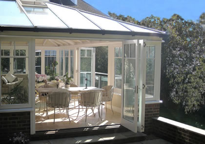 Folding Sliding Doors open this Conservatory onto a terrace in Wimbledon